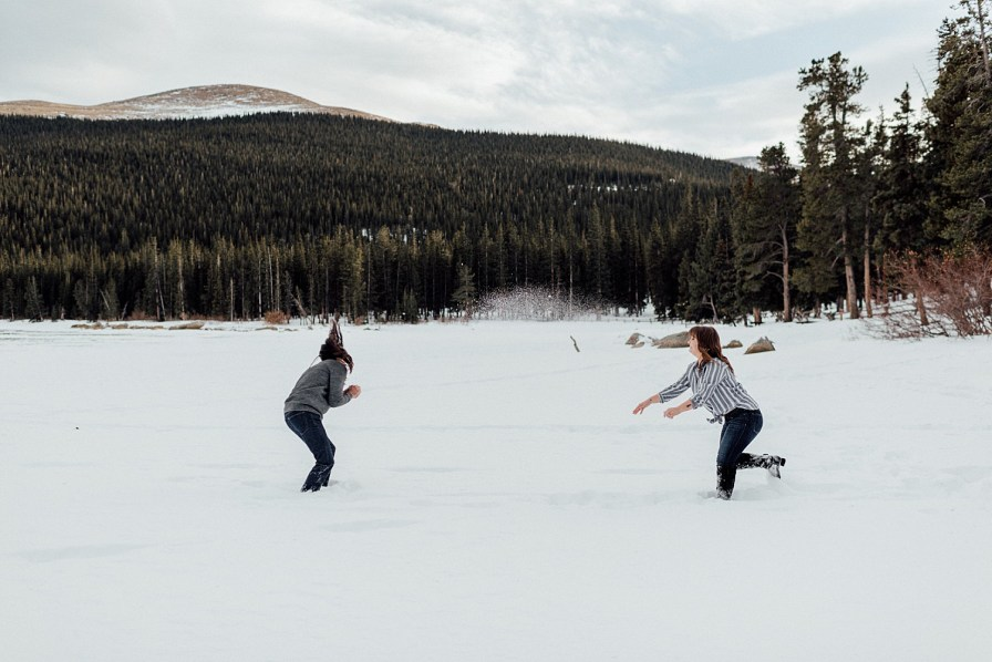Snowball fight for winter engagement photos