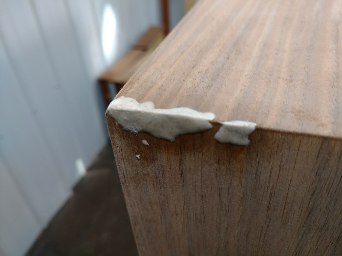 Jens Risom Credenza: Left end, defects epoxy filled.