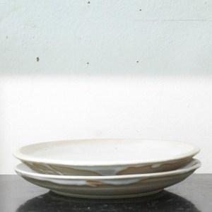 Erik Haugsby Pottery set of two white ceramic plates with handmade nuka glaze