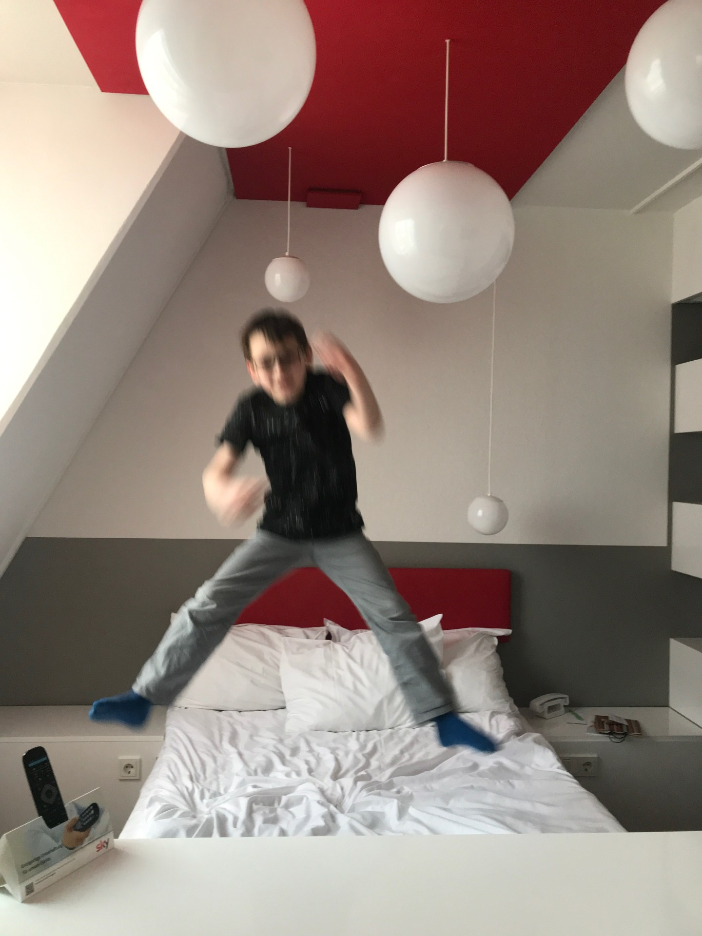 My son jumping for joy at Ibis Styles hotel in Aachen. It might have had something to do with the make-your-own pancake machine downstairs.