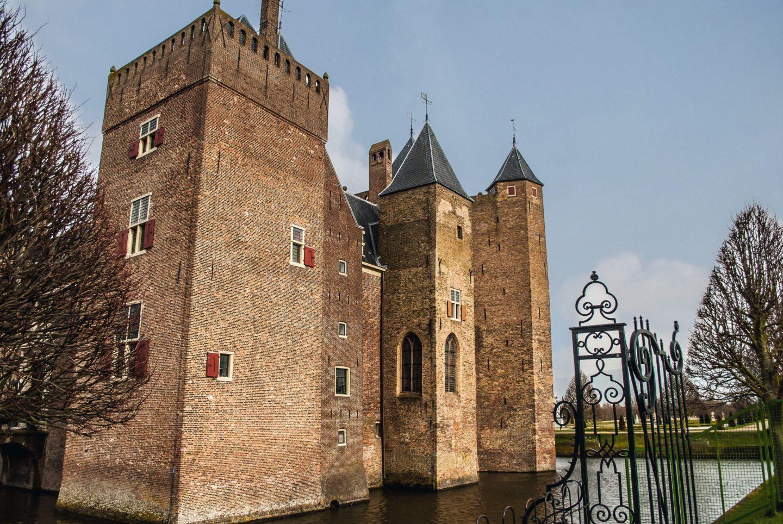 The impressive Assumburg Castle and moat in Heemskerk, the Netherlands.