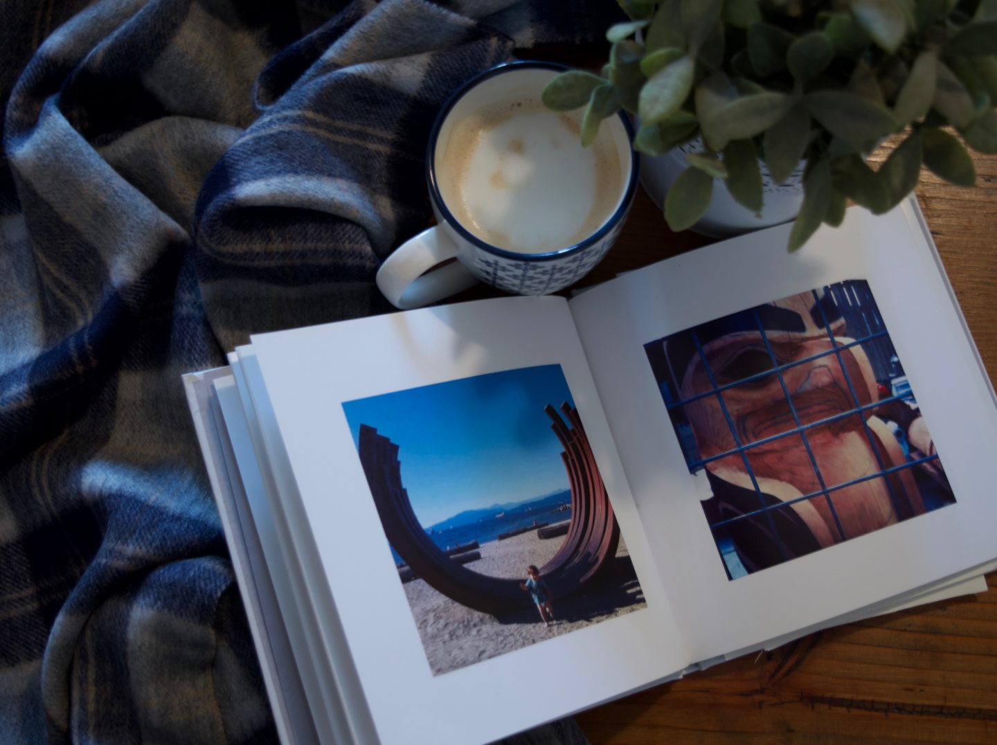 One of my many travel photo books... my son loves looking at them. And yes, that's my cozy Tartan Blanket Co. scarf there too