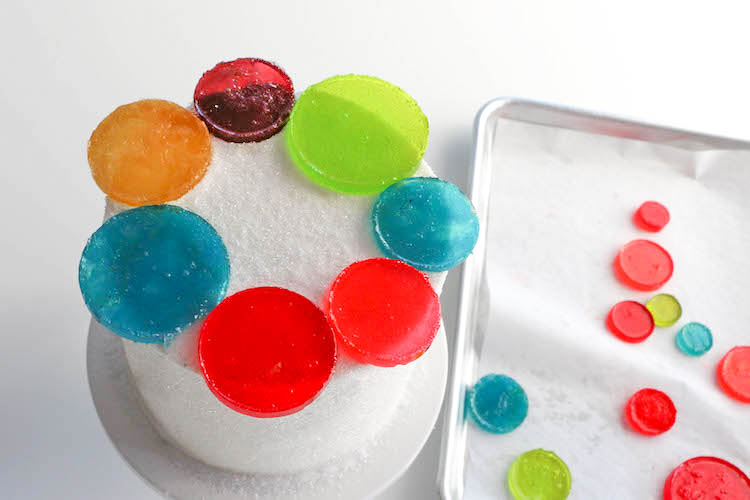 Arranging the Candy Circles on the Cake   Erin Bakes   Erin Gardner