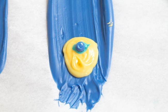 Piping Royal Blue Chocolate onto the Feather   Erin Gardner   ErinBakes
