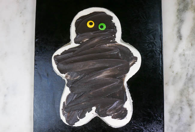 Adding Candy Eyes to the Mummy Cake | Erin Bakes