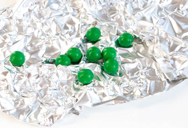 Green Sixlets on Crumpled Aluminum Foil | Erin Bakes