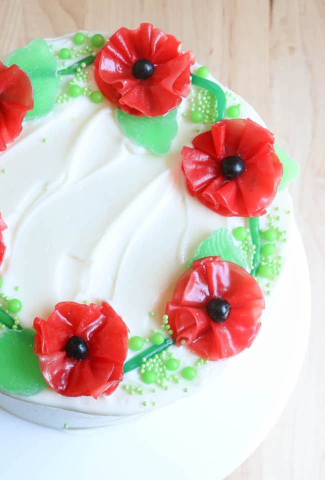 Fruit Roll-Up Flowers on a Cake with Candy Leaves | Erin Bakes