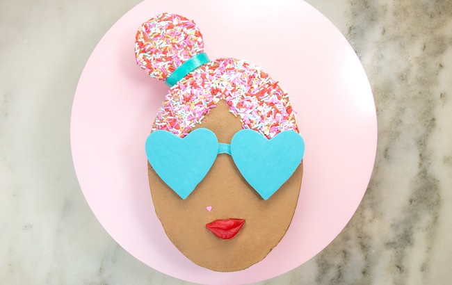 Oval cake finished with chocolate buttercream, sprinkle hair, and chocolate sunglasses | Erin Gardner | Erin Bakes