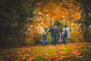 Seattle family photographer captures beautiful golden Autumn leaves and a family of four