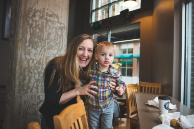 Mom smiling with young boy inside Top Pot Donuts in Redmond WA by Seattle family photographer