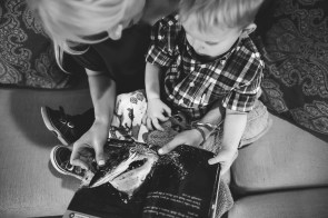 Black and white photo of mother and young son reading