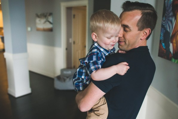 Family photo with young boy and dad by a Seattle Family Photographer