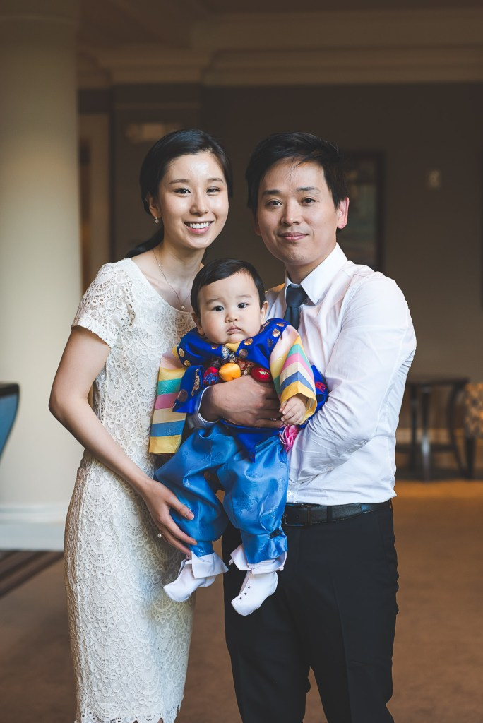 Posed portrait of a Korean family with traditional Korean first birthday outfit