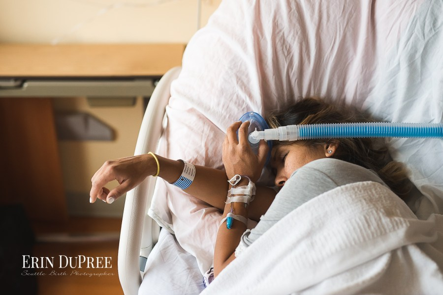 Woman in labor using nitrous oxide by Seattle Birth Photographer