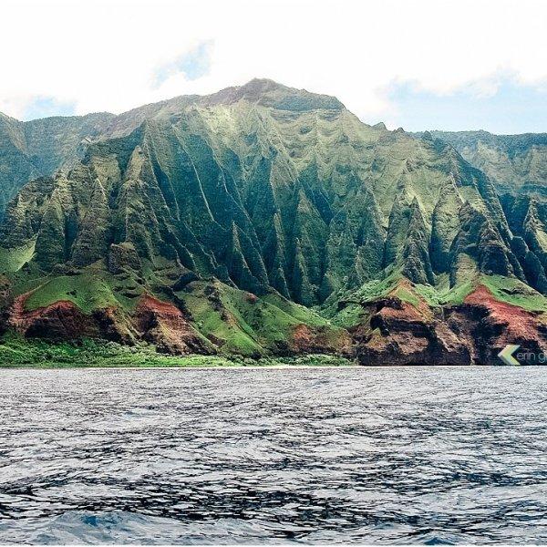 view of stunning green cliffs of the Na Pali Coast on Kauai