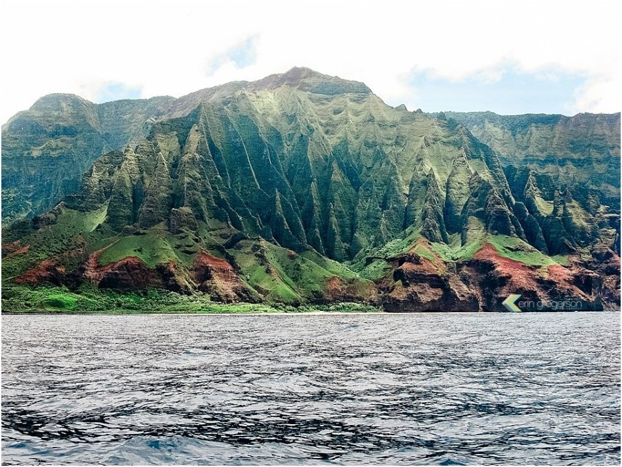 Top five things to do on Kauai: view of stunning green cliffs of the Na Pali Coast on Kauai