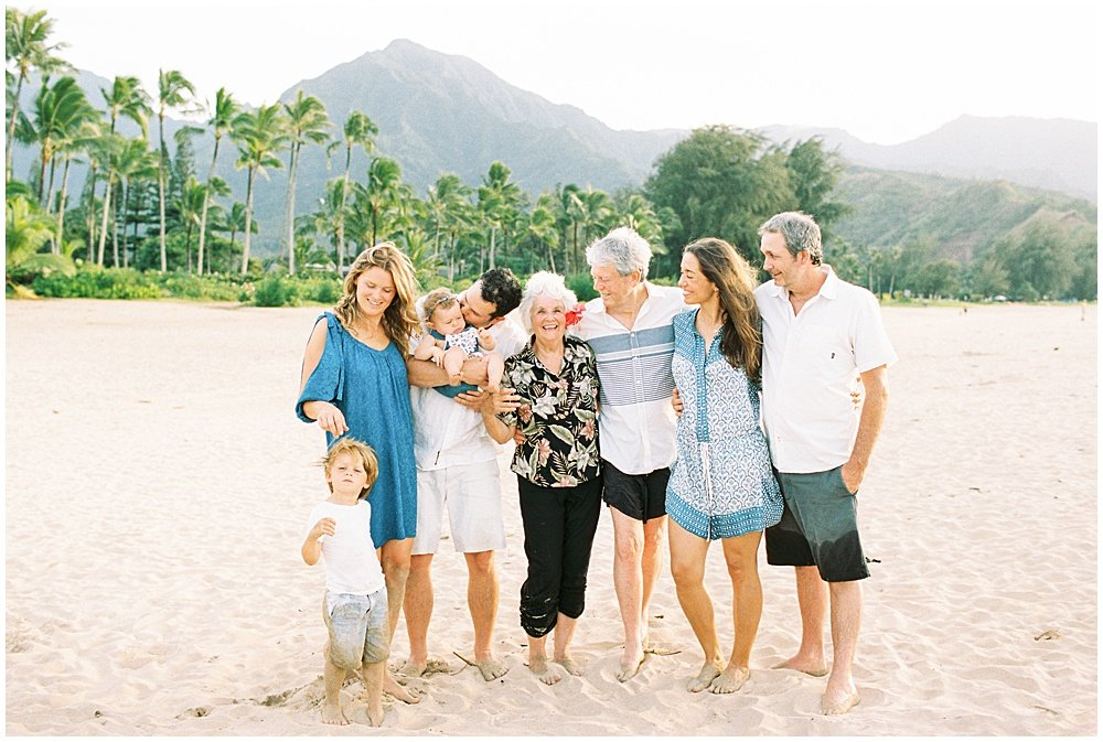 Photos of family at Hanalei Bay sunset session