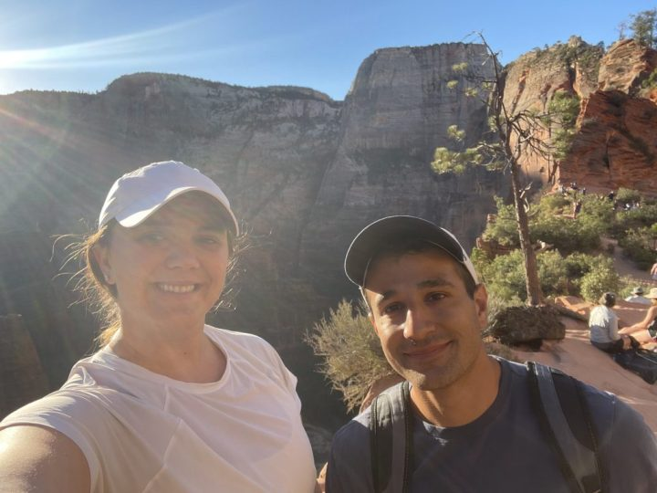 erin and matt on top of angels landing during their two days in zion national park