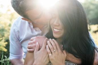 Sunburst behind couple with man kidding woman on cheek