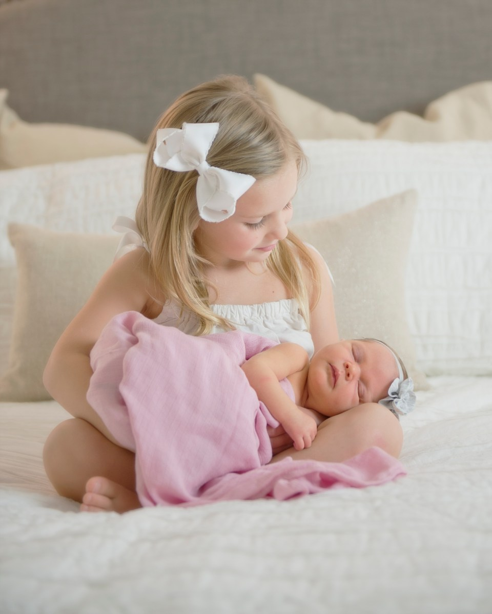 Sisters in Pink and White Newborn Session