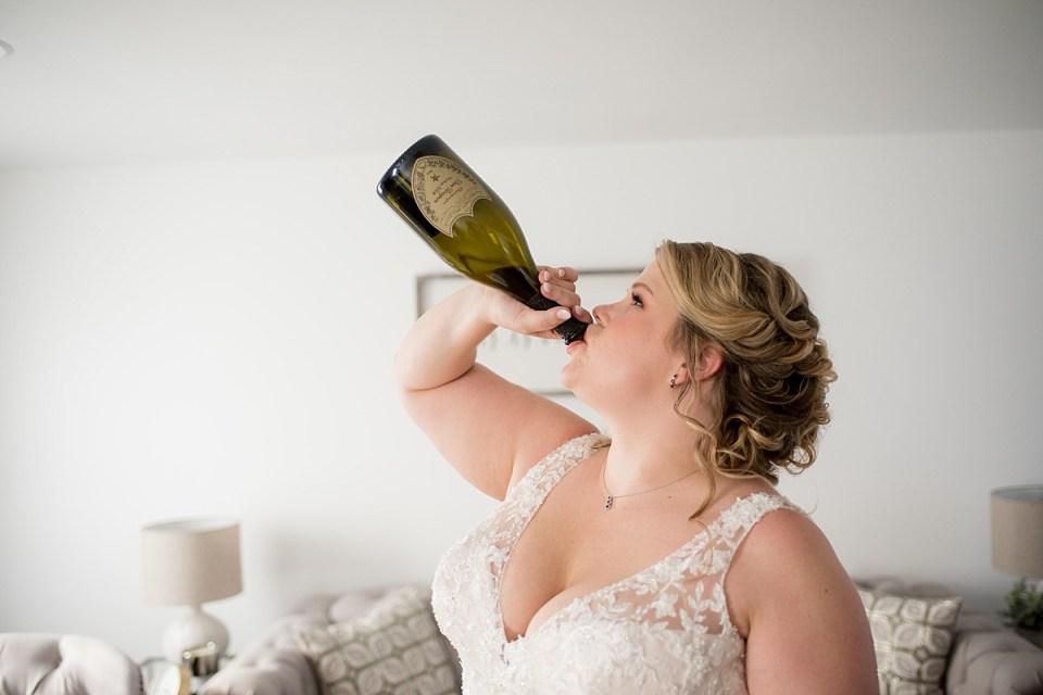 Bride drinking Dom Perignon at 48 Fields wedding in Leesburgh, VA
