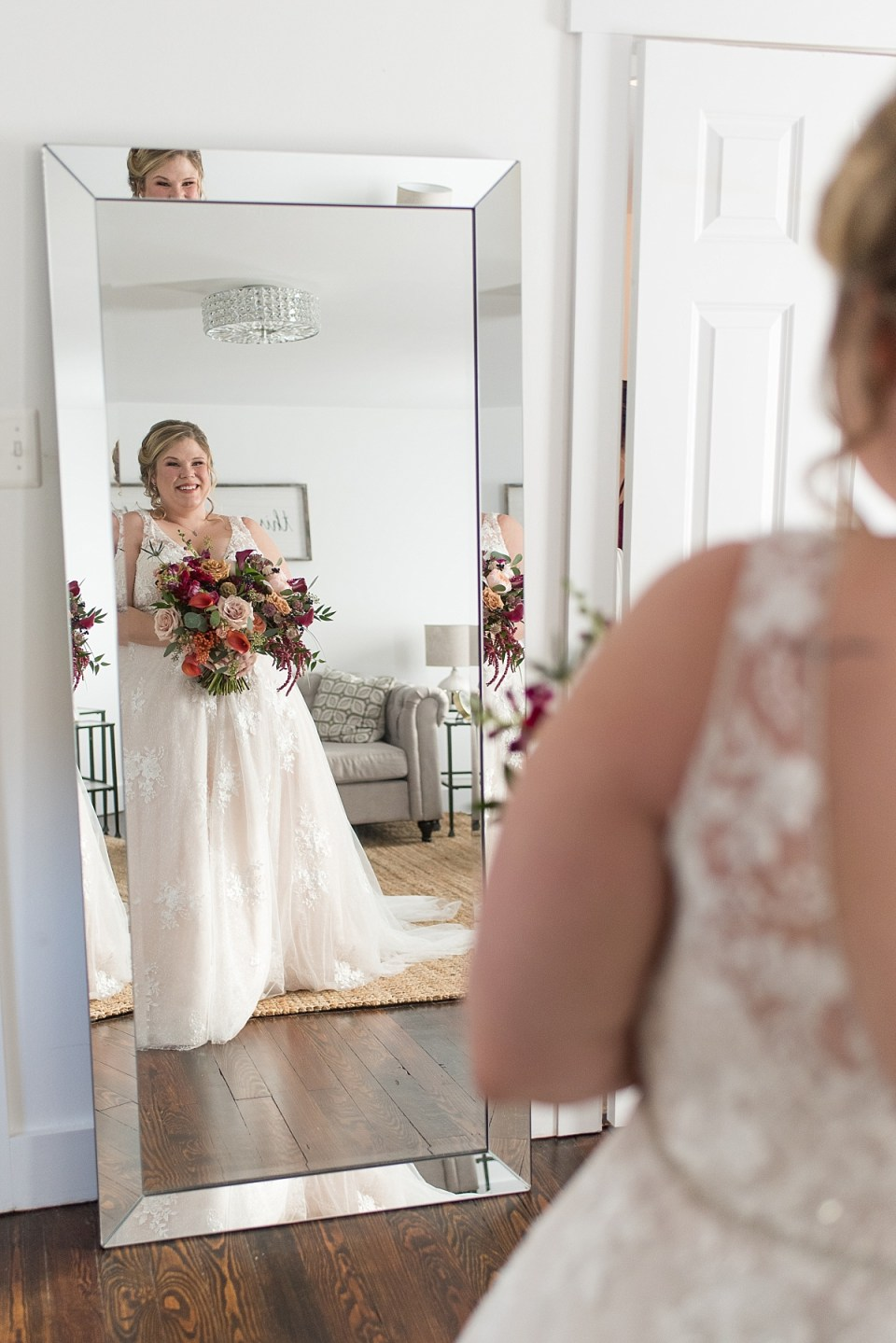 Reflection of bride in mirror at the farmhouse at 48 Fields Wedding