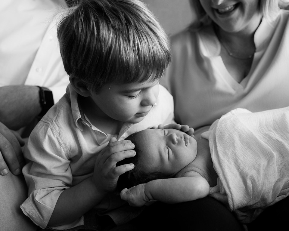 Newborn Photography with sibling in black and white