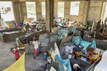 Displaced people in Shire campus building