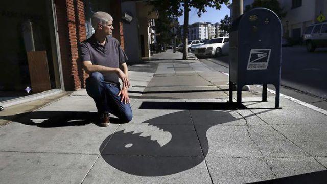 Damon Belanger, artista callejero, sombras, banqueta