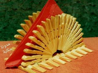 Servilletero hecho con pinzas de madera para ropa