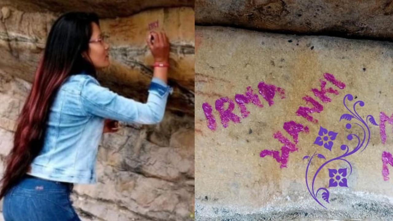 Mujer raya su nombre en pinturas rupestres