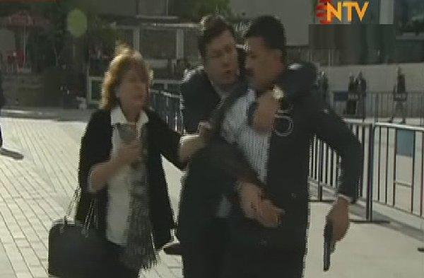 Can Dündar's wife Dilek Dündar after the shooter...
