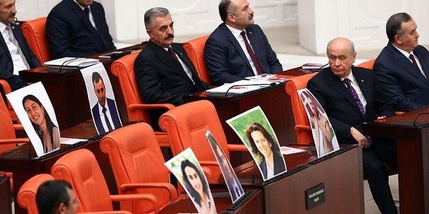 Devlet Bahçeli gazing at photos of HDP deputies in jail...