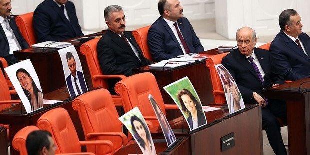 Devlet Bahçeli gazing at photos of HDP deputies in jail...
