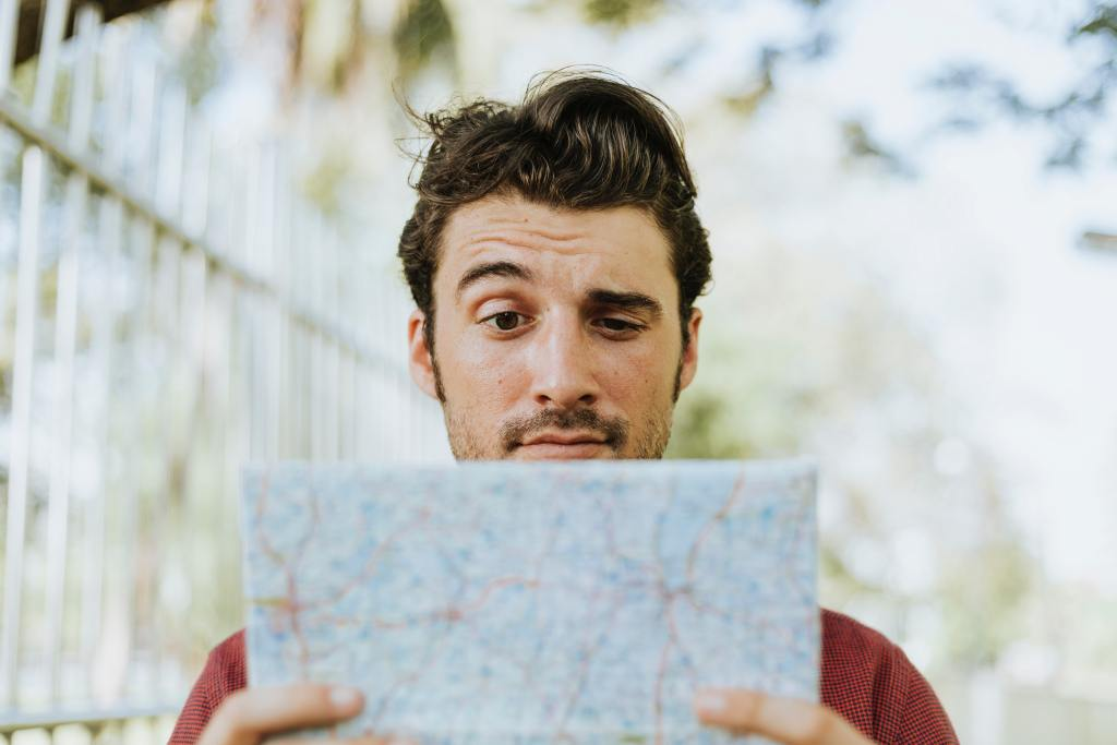 a man looking confused holding a map