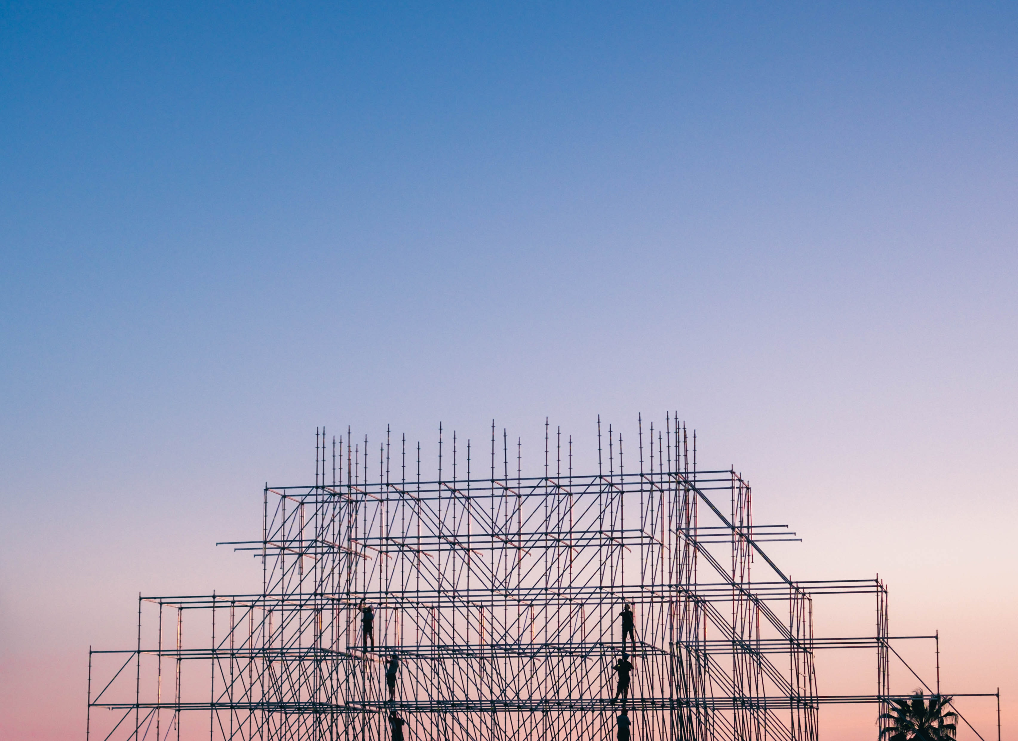 photo-of-people-on-building-under-construction-1117452