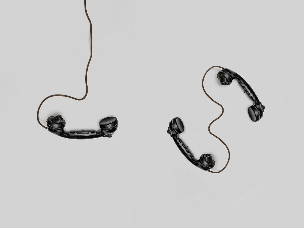 three black corded telephones