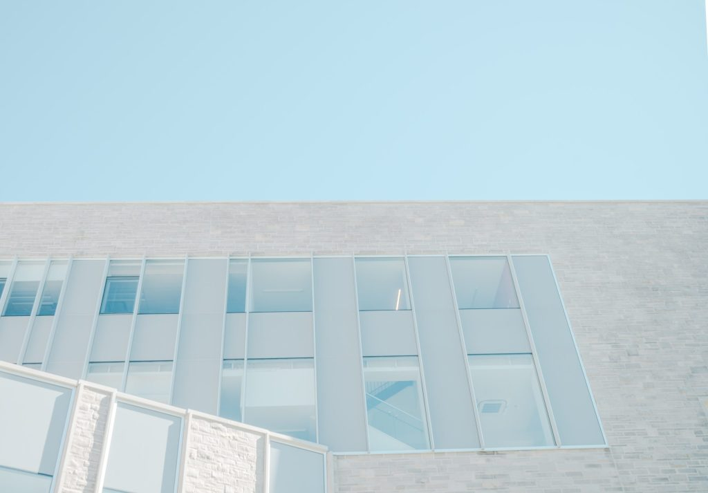 gray wall with windows and blue sky