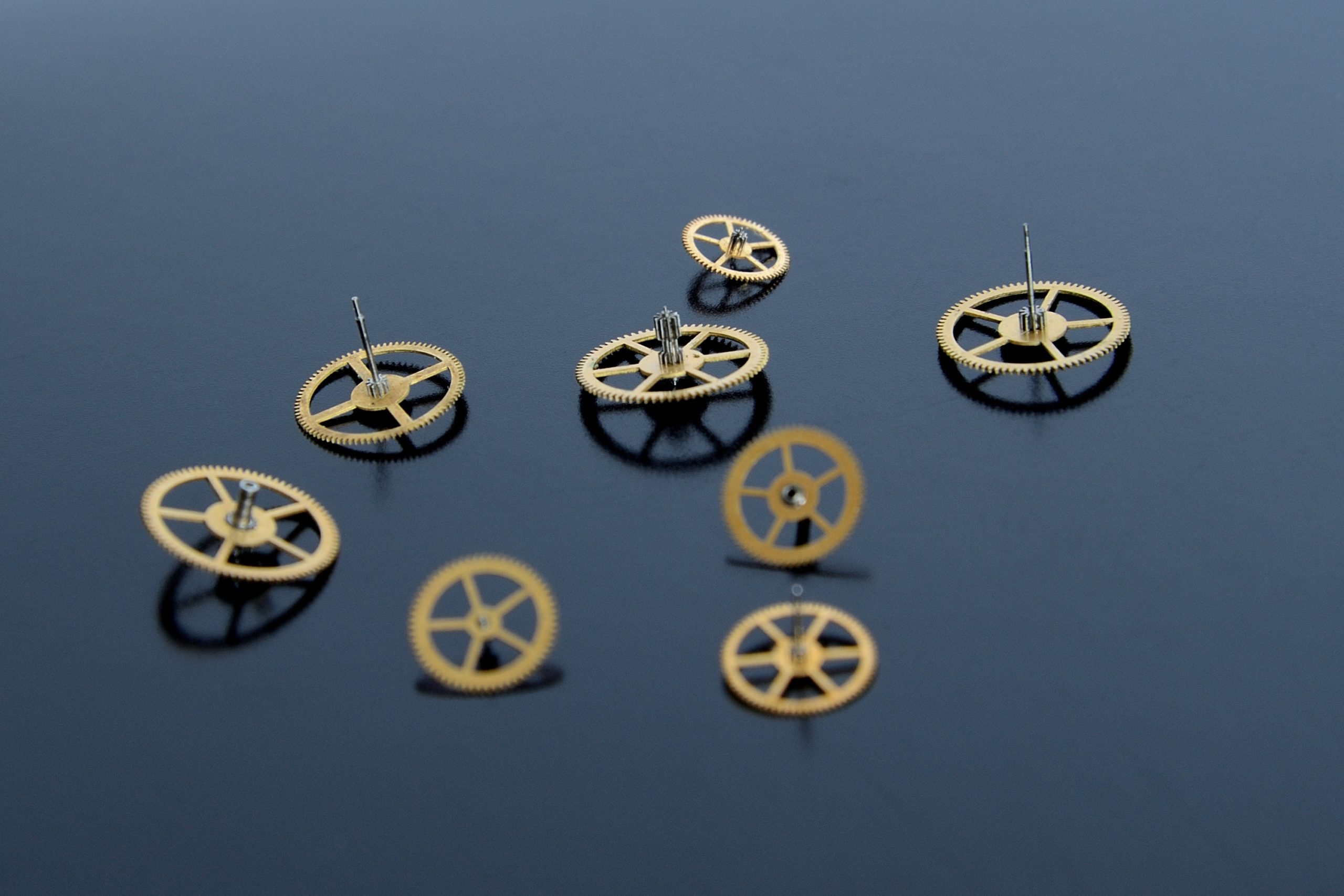 gold gears on a black desk