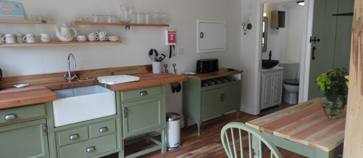 Handmade sage green kitchen at the Newchurch Nook