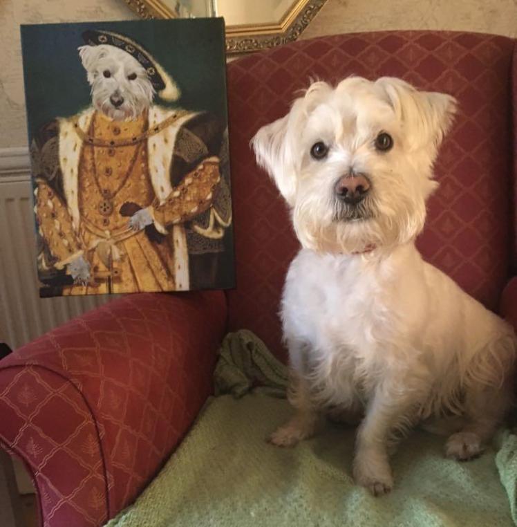 Ernie poses by his regal portrait