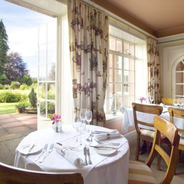 Dining room at Trigony House with doors opening out on to the garden