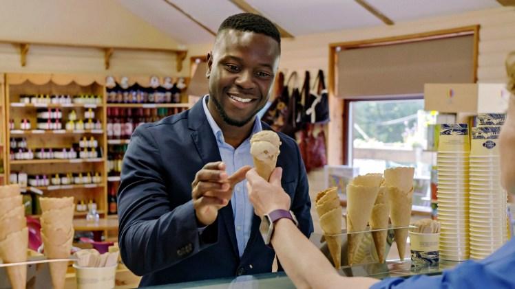 Man enjoys an ice cream at Cream of Galloway
