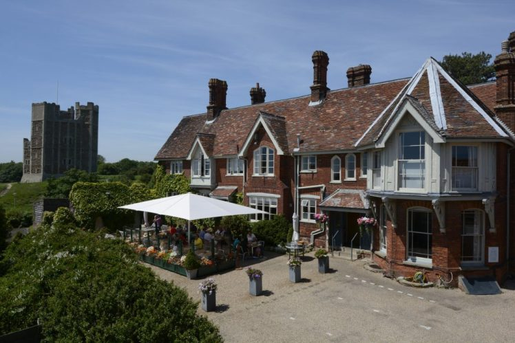 Exterior of the Crown & Castle in Orford - with castle in the background