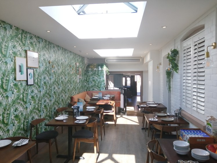 Restaurant at the Oyster Smack Inn, Burnham with funky palm print wallpaper and skylight