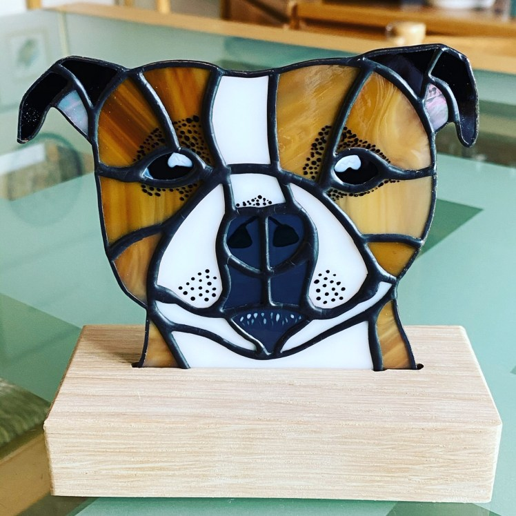 A stained glass Staffy