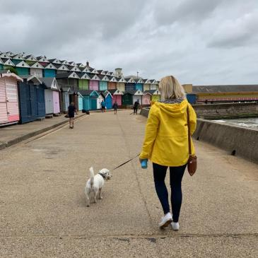 Ernie and mum Jenny walk past colourful beach huts in Walton-on-the-Naze