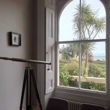 Telescope looking out at sea view from Victorian Beach House, Hastings