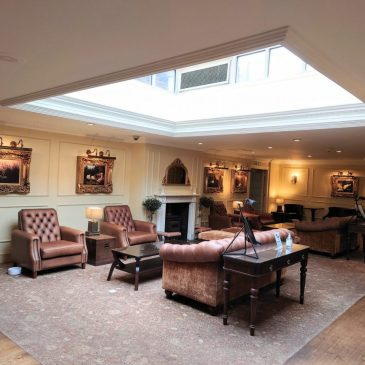 Chesterfields and paintings in reception area at the Swan's Nest Hotel, Stratford-upon-Avon