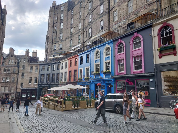Colourful shops and restaurants in Victoria Street, Edinburgh